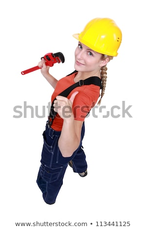 Tradeswoman giving the thumb's up and holding a pipe wrench Stock photo © photography33