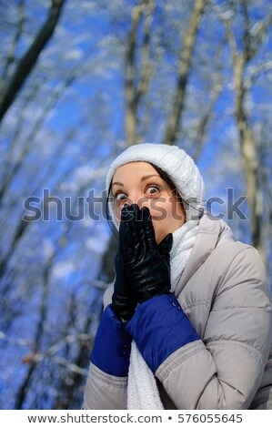 Playful young brunette wrapped in blue cloth stock photo © acidgrey