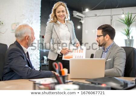 Człowiek kobieta finansowych wyniki działalności biuro Zdjęcia stock © photography33