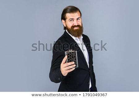 бизнесмен питьевой колба человека пить бутылку Сток-фото © joseph73