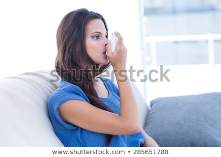 Woman using asthma inhaler in living room Stock photo © wavebreak_media
