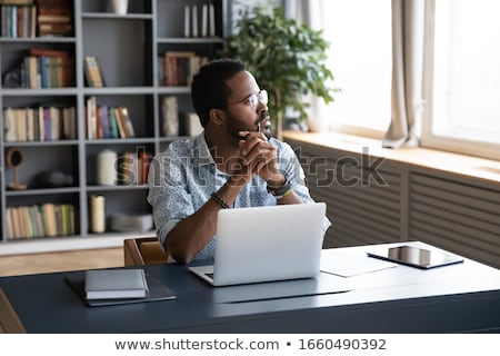 Anxious businessman looking at laptop Stock photo © Rugdal