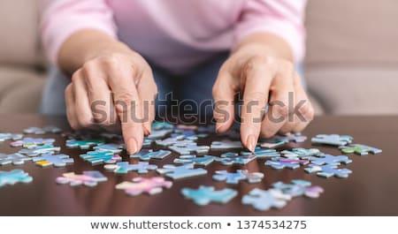 hands doing a puzzle Stock photo © Nelosa