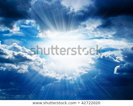 The suns rays break through the clouds Stock photo © lovleah