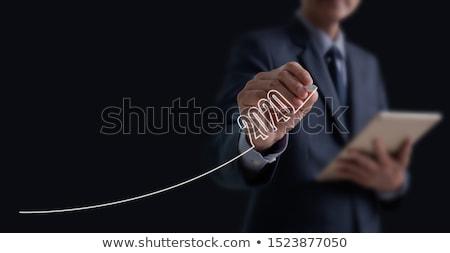 Revenue Concept on Dark Digital Background. Stock photo © tashatuvango