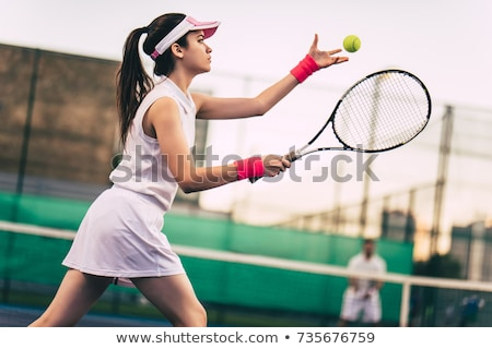 Foto stock: Girl Playing Tennis On The Court
