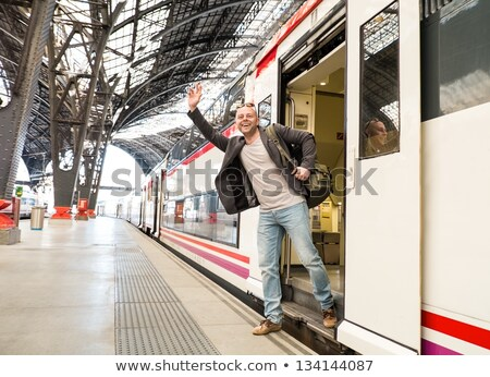 MIddle-aged tourist with backpack meeting someone in railroad station building Stock photo © Nejron