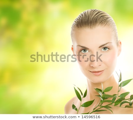 beautiful young woman over abstract blurred background stock photo © nejron