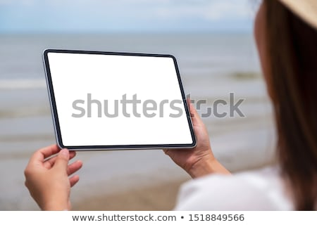 tablet with a black blank space in the screen, in the sand of a  Stock photo © nito