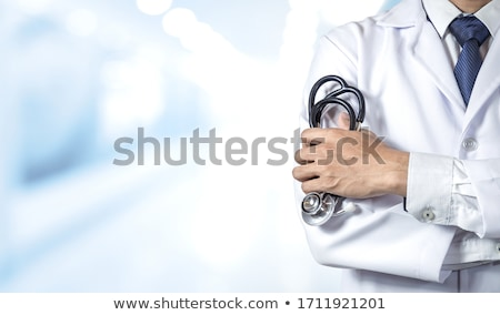Doctor health care professional cardiologist with stethoscope holding heart Stock photo © ichiosea