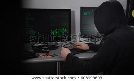 Koncentrált hacker gépel billentyűzet fehér egér Stock fotó © wavebreak_media