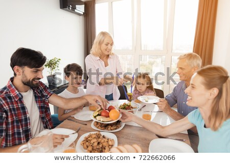Stock photo: doe family is eating
