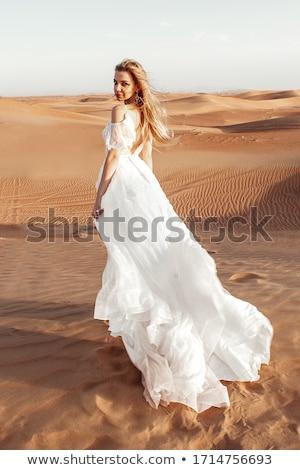 Bella sposa abito bianco lungo i capelli ricci Foto d'archivio © NeonShot