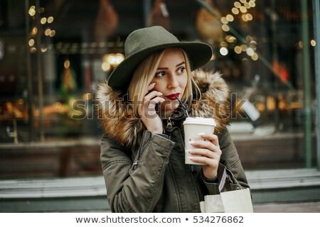 Gyönyörű piros kapucnis nő iszik kávé Stock fotó © stevanovicigor