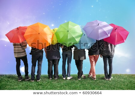 the group of people stands with the umbrellas on to meadow  Stock photo © Paha_L