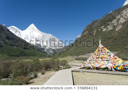 Tibet snow mountain with Mani Dui Stock photo © paulwongkwan
