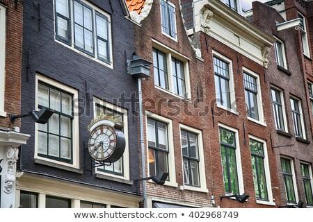Details of Clock in street Nieuwe Spiegelstraat in Amsterdam, th Stock photo © vladacanon