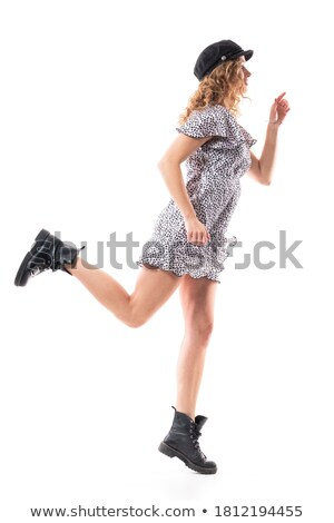 side view of a young attractive woman with fluttering hair Stock photo © feedough