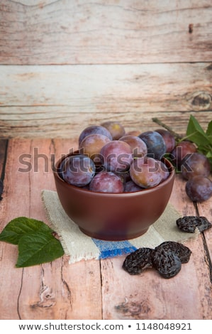 Bowl with plums on blue shabby wooden background Stock photo © vlad_star