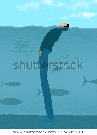 a man keeping his head above the water stock photo © bluering