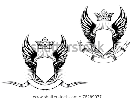 Stock photo: shield with wings and ribbon. heraldic shapes