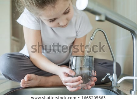 Stock photo: Child drinking pure water in nature