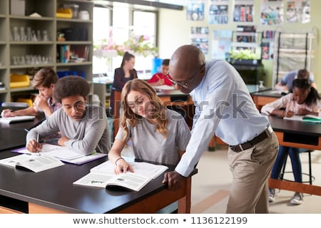 School leraar leerboek blond Rood blouse Stockfoto © robuart
