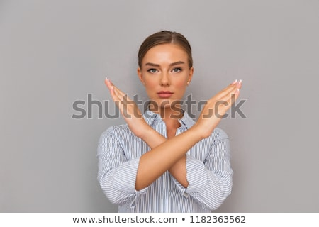 young businesswoman with crossed hands Stock photo © leedsn