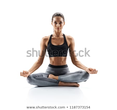 Young woman practicing yoga on white background studio Stock photo © ambro