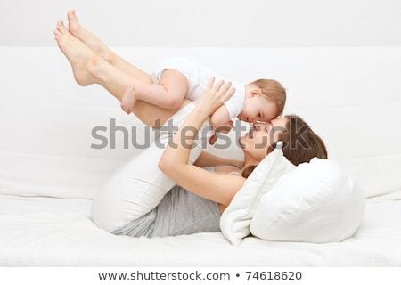 Szépség anya baba kanapé felfelé portré Stock fotó © deandrobot
