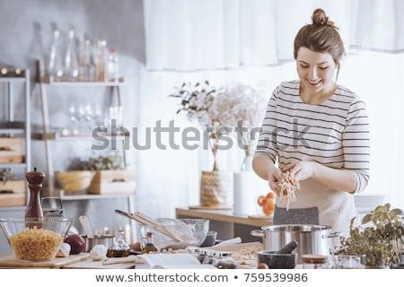 gelukkig · koken · vrouw · permanente · nieuwe - stockfoto © racoolstudio