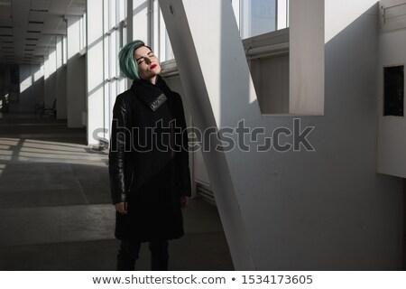 Kadın kırmızı kat ayakta gözleri kapalı koridor Stok fotoğraf © deandrobot