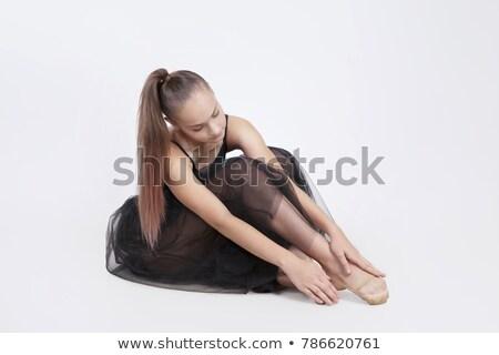 young ballet dancer wearing black transparent dress sitting on floor stock photo © julenochek
