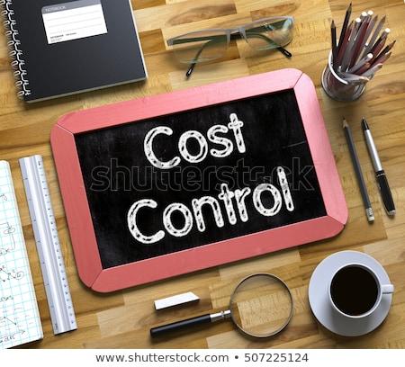 cost control handwritten on small chalkboard 3d stock photo © tashatuvango