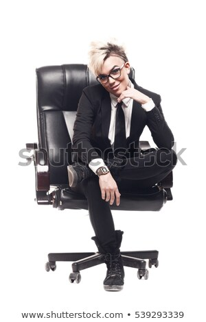 full length portrait of a happy cheerful businesswoman in suit stock photo © deandrobot