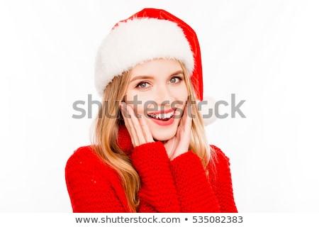blonde girl in santa hat stock photo © pilgrimego