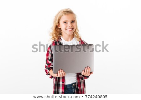 Portrait of a satisfied little girl holding laptop computer Stock photo © deandrobot