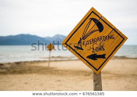 Kiteboarding, wooden kitesurfing sign on beach Stock photo © blasbike