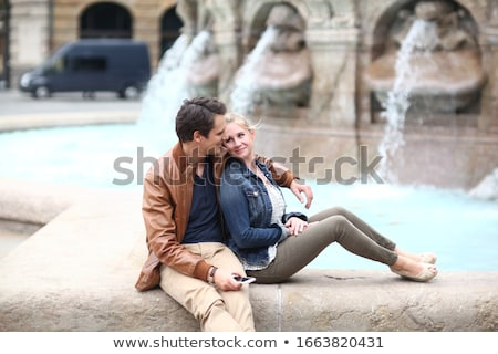 Couple sitting next to fountain Stock photo © IS2