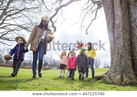 children carrying basket of easter eggs stock photo © is2