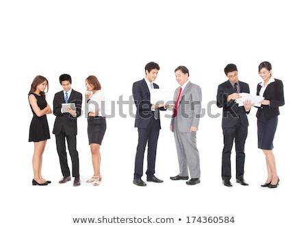 Asiático empresário em pé documentos mão corporativo Foto stock © studioworkstock