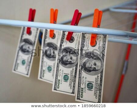 Rood wasknijper dollar witte hout cash Stockfoto © devon