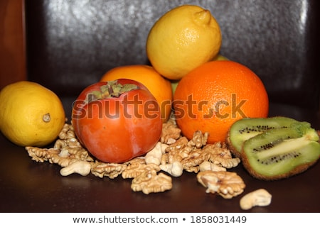Stock photo: Green and orange Pumpkin, persimmons, ingredients, decorations