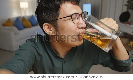 man with smartphone and bottle of beer at night Stock photo © dolgachov