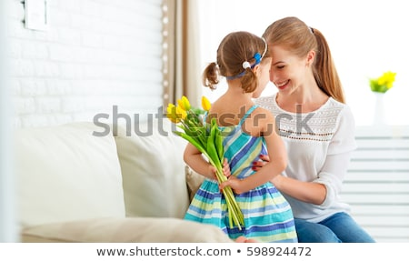 Happy mother with her childrens at home Stock photo © Lopolo