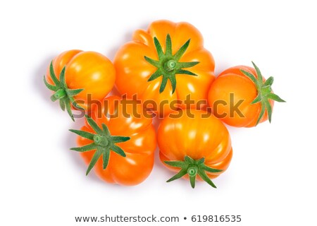 Yellow ribbed tomatoes, paths, top view Stock photo © maxsol7