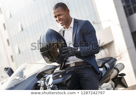счастливым молодые бизнесмен сидят мотоцикле улице Сток-фото © deandrobot