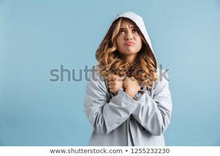 Imagem chateado mulher 20s capa de chuva Foto stock © deandrobot