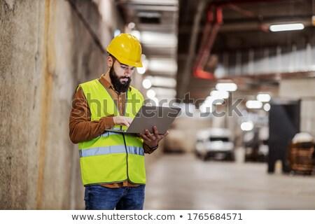 Construction worker with laptop Stock photo © CsDeli
