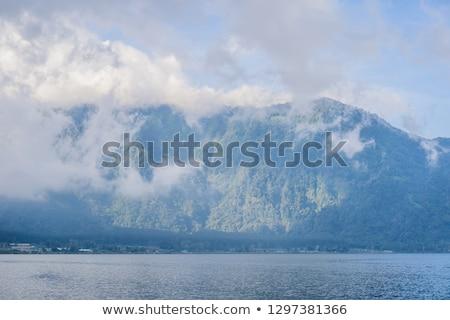 Amazing views of Lake Bratan and the mountains covered with clou Stock photo © galitskaya
